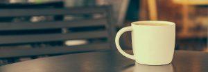 white mug with beverage